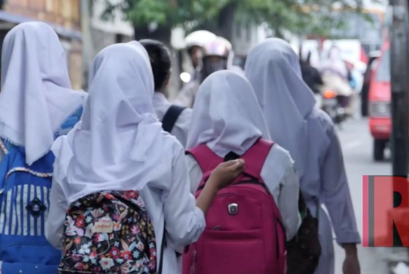 (Ilustrasi) Pelajar sekolah negeri di Jakarta mulai beraktivitas.