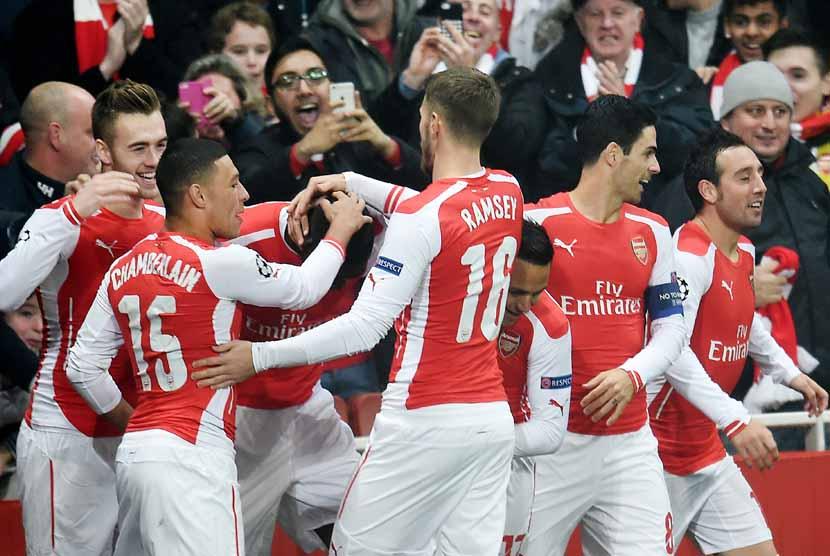 Pemain Arsenal melakukan selebrasi.
