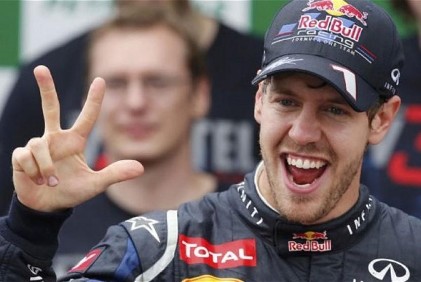 Pembalap Sebastian Vettel pindah ke Ferrari.
