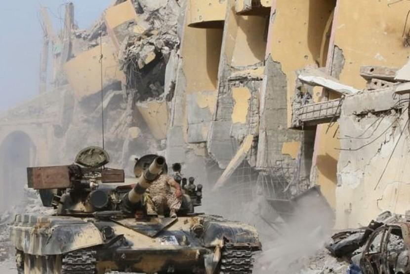 Pertempuran yang terjadi di pangkalan udara Brak El Shati, Libya, Jumat (19/5).