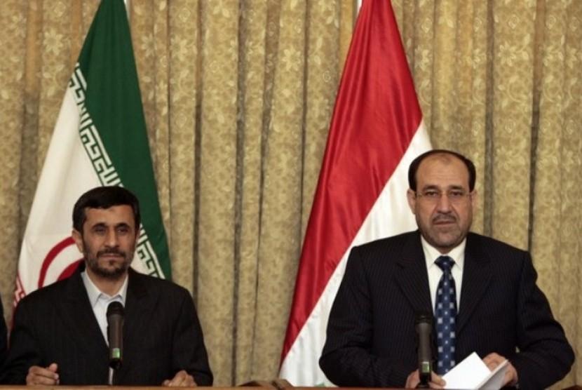 Presiden Iran Mahmoud Ahmadinejad dengan PM Irak Nouri Al-Maliki