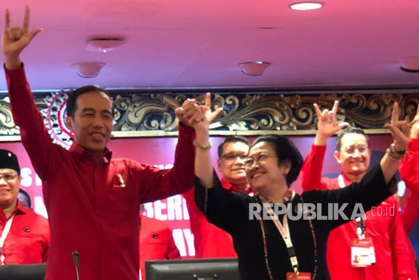 Joko Widodo (Jokowi) and Chairperson of Indonesian Democratic Party of Struggle (PDIP) Megawati Soekarnoputri raise their hands after reappointment of Jokowi as presidential candidate in presidential election 2019.