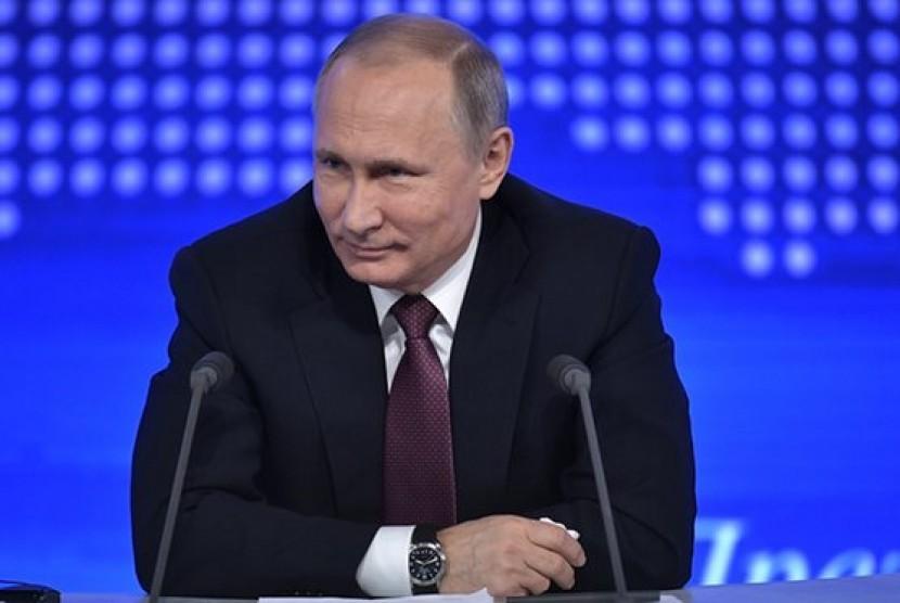 Presiden Rusia Vladimir Putin saat konferensi pers tahunan di Moskow, Jumat, 23 Desember 2016.