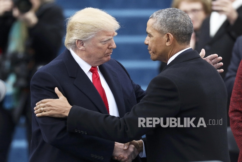 President Barack Obama (R) greets President elect Donald Trump at inauguration ceremonies swearing in Donald Trump as the 45th president of the United States on the West front of the U.S. Capitol in Washington, U.S., January 20, 2017.