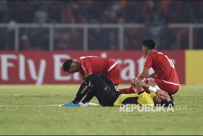 Sejumlah pesepak bola Persija Jakarta meluapkan kekecewaannya usai pertandingan melawan Home United.