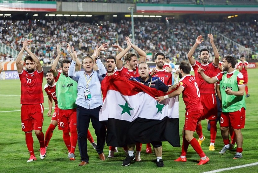 Selebrasi tim Suriah setelah memastikan satu tempat di play-off Piala Dunia 2018 zona Asia.