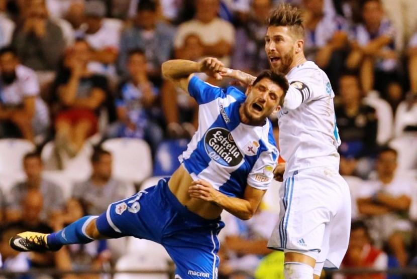 Sergio Ramos (kanan).