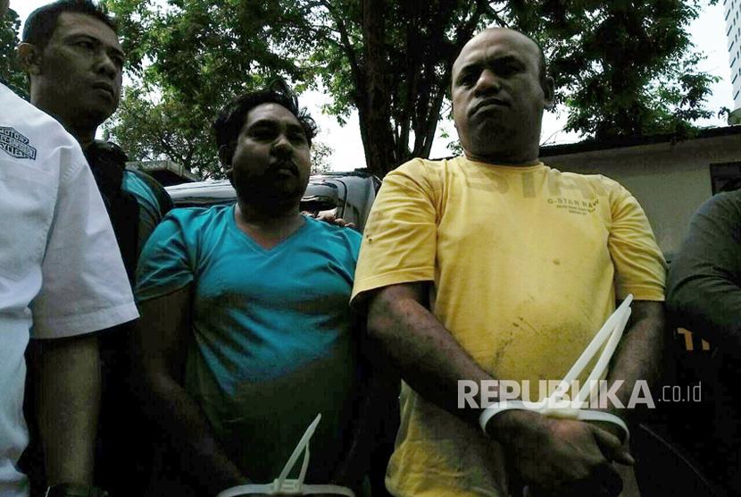 Tersangka Pembacokan Hermansyah digiring ke Ditreskrimum Polda Metro Jaya, Rabu (12/7).