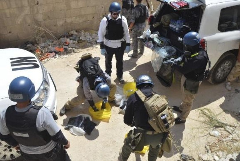 UN chemical weapons experts prepare before collecting samples from one of the sites of an alleged chemical weapons attack.
