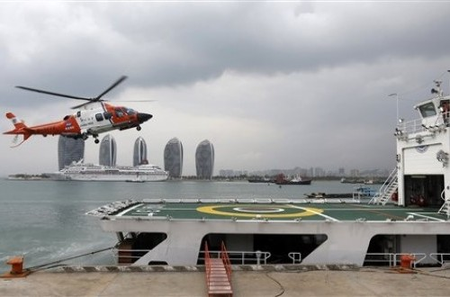 A helicopter prepares to land onboard the China Maritime Safety Administration (MSA) ship Haixun-31 during a brief stop in Sanya in southern China's Hainan province Sunday March 9, 2014. The ship is expected to join an ongoing search for the missing Malays