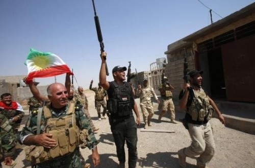 Kurdish peshmerga forces celebrate as they take control of Sulaiman Pek from the Islamist State militants, in the northwest of Tikrit city September 1, 2014.
