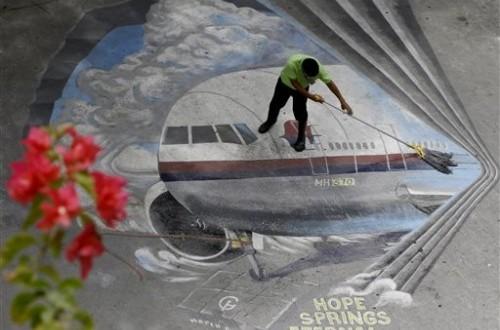 mural-tentang-hilangnya-pesawat-malaysia-airlines-mh370-_140520184224