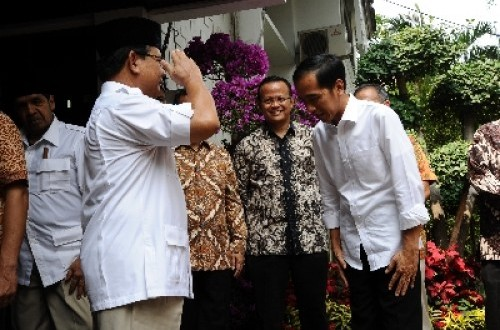 Symbolic gestures between icons of two political coaltions, Prabowo Subianto and Jokowi.