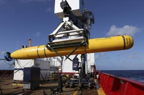 The Phoenix International Autonomous Underwater Vehicle (AUV) Artemis is craned over the side of Australian Defence Vessel Ocean Shield in the Southern Indian Ocean.