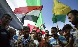 Palestinians in Gaza City welcome the reconciliation of Hamas and Fatah on Thursday (October 10).