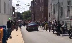 Foto yang diambil dari video milik Brennan Gilmore menunjukkan sebuah mobil yang baru saja menabrak demonstran di Charlottesville, Virginia, AS, Sabtu (12/8) waktu setempat. Setidaknya satu orang meninggal karena kejadian tersebut.
