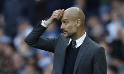 Reaksi pelatih Manchester City, Pep Guardiola pada laga Liga Primer melawan Southampton di stadion Etihad, Ahad (23/10). Hasil seri 1-1 membuat City memiliki raihan angka sama dengan Arsenal dan Liverpool di puncak klasemen.