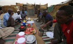 South Sudanese Muslim men break fast together, during the holy month of Ramadan, inside a mosque in Andalus camp in Khartoum, July 10, 2014.