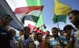 [ilustrasi] Warga Palestina di Gaza City, Kamis (12/10), menyambut gembira kesepakatan rekonsiliasi antara Hamas dan Fatah.