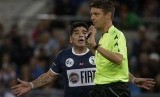 Argentine soccer legend Diego Armando Maradona argues with referee Gianluca Rocchi during an inter-religious soccer match for peace, at Rome's Olympic Stadium, Monday, Sept. 1, 2014.