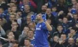 Diego Costa merayakan gol.
