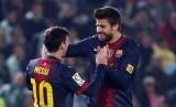 Gerrard Pique dan Lionel Messi