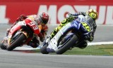 Italian MotoGP rider Valentino Rossi (R) of the Movistar Yamaha MotoGP team is on his way to win the Motorcycling Grand Prix TT Assen at the TT Circuit in Assen, Netherlands, 27 June 2015. Rossi won ahead of second placed Spanish rider Marc Marquez (L) of
