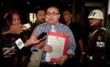 Kuasa hukum Komjen Budi Gunawan, Rasman Arif Nasution melaporkan pimpinan KPK ke Kejaksaan Agung di Jakarta, Rabu (21/1).