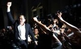 Malaysian opposition leader Anwar Ibrahim shouts to his supporters at a court house in Putrajaya March 7, 2014.