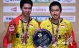 Pasangan ganda putra Indonesia Kevin Sanjaya Sukamuljo (kiri) dan  Markus Fernaldi Gideon pada final ganda putra Japan Open Championship di Tokyo, Jepang Ahad (24/9)