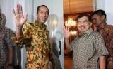 Presiden dan Wapres terpilih Joko Widodo, dan Jusuf Kalla menggelar konferensi pers di rumah Dinas Gubernur, Jakarta, Kamis (21/8).