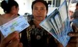 Program kompensasi kenaikan BBM berupa Bantuan Langsung Tunai (BLT). (ilustrasi)