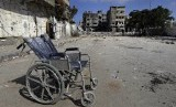 A wheelchair is abandoned near a house hit by Israel in Gaza Strip on Sunday as the Palestinian death toll mounts to 1,031. (Ilustration)