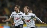 Tottenham Hotspur's Christian Eriksen (R) celebrates scoring a goal with team-mate Jan Vertonghen during their English Premier League soccer match against Hull City at the KC Stadium in Hull, northern England November 23, 2014.