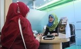 Transaction in an islamic banking in Bekasi, West Java. (illustration)