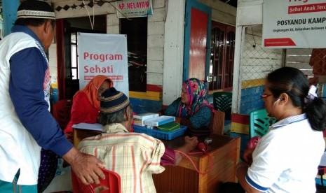 Masyarakat Kampung Nelayan Manfaatkan Waktu Ikut Posyandu