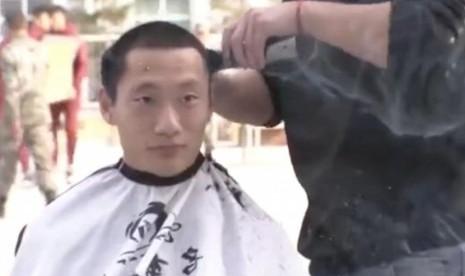 Cina Paksa Pesepakbola Ikut Pelatihan Militer