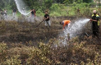 In Picture: Pemadaman Kebakaran Hutan di Aceh dan Riau