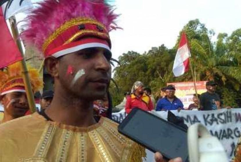 Sejumlah warga dan mahasiswa asal Papua saat menggelar aksi damai untuk Bumi Papua, Senin (2/9/2019). Foto/Wardoyo