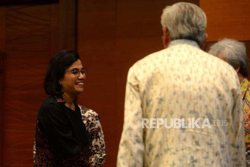 Deklarasi Peningkatan Transaksi Rupiah. Menteri Keuangan Sri Mulyani Indrawati memasuki ruangan penandatanganan nota kesepahaman terkait deklarasi bersama peningkatan transaksi rupiah di Kantor Kemenkeu, Jakarta, Rabu (3/10).