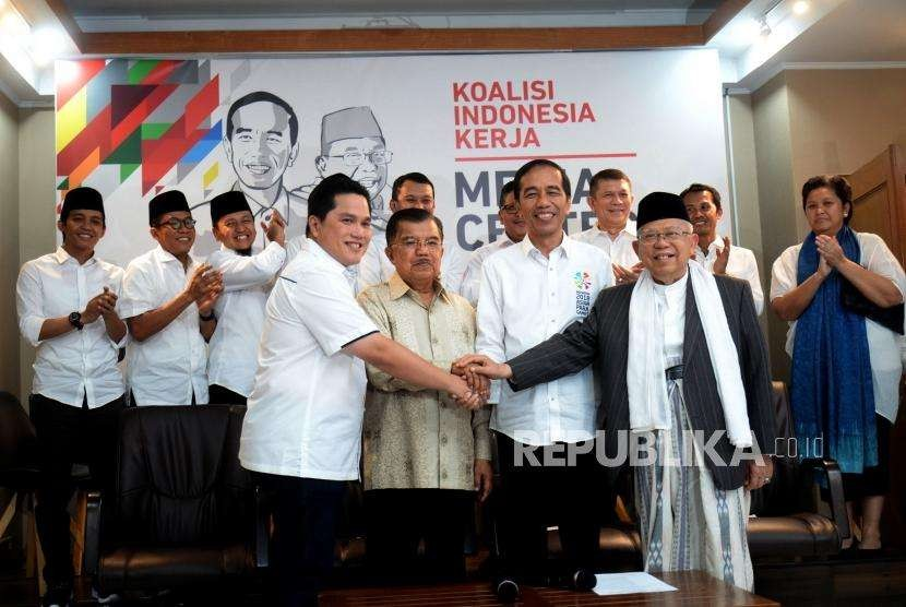 Incumbent President Joko Widodo (second right) hold hands with Vice Presidential Candidate KH Maruf Amin (right), Vice President Jusuf Kalla (second left) as chief of Steering Committe of National Campaign Team, and businessman Erick Thohir as chief of his National Campaign Team in Jakarta, Friday (Sept 7).