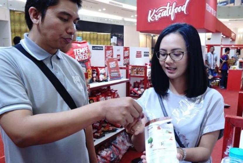 TomaTomi Tarik Perhatian Pengunjung Food Startup Indonesia, Siapa Dia?. (FOTO: Bekraf)