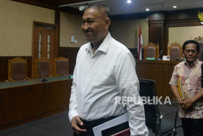 Terdakwa kasus dugaan korupsi e-KTP Markus Nari meninggalkan ruangan usai mengikuti sidang dakwaan di Gedung Pengadilan Tipikor, Jakarta, Rabu (14/8).