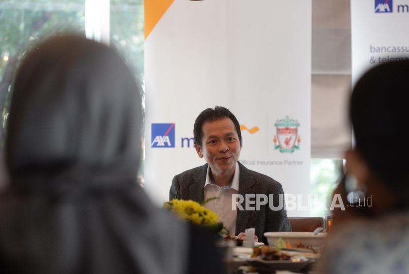 Presdir AXA Mandiri Baru.Presiden Direktur AXA Mandiri yang baru Handojo G Kusuma menyampaikan paparan saat perkenalan Presdir di Jakarta, Kamis (10/1/2019).