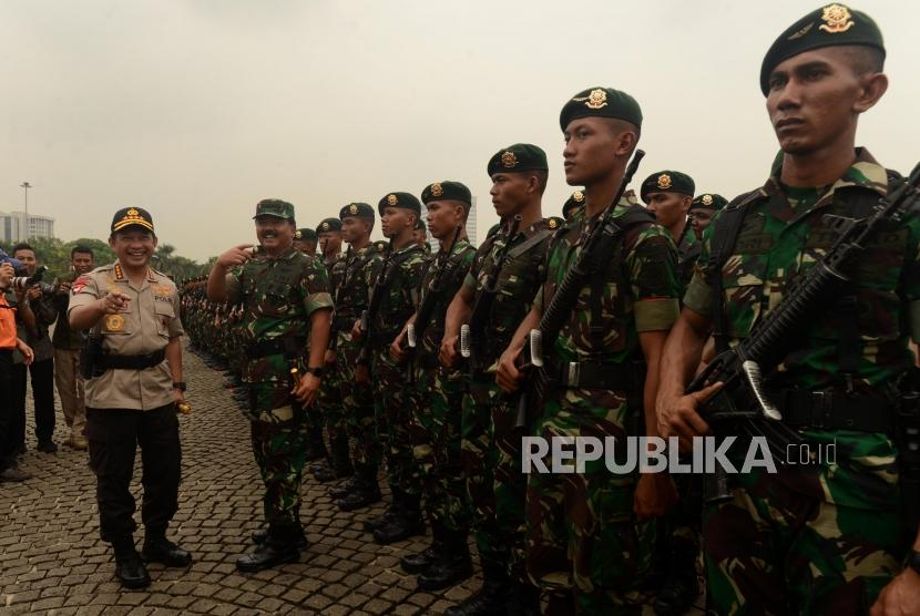TNI Chief Marshal Hadi Tjahjanto and National Police Chief General Tito Karnavian lead  roll call ceremony on the preparations for Christmas, New Year's Eve 2019, and the presidential and legislative elections in Monas, Jakarta, Friday (Nov 30).