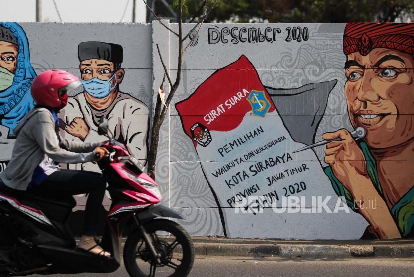 [Ilustrasi] Mural sosialisasi serta ajakan kepada masyarakat untuk menggunakan hak pilihnya pada pemilihan Wali Kota dan Wakil Wali Kota Surabaya tahun 2020 di Surabaya.