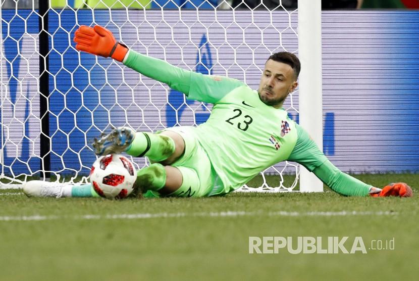 Penjaga gawang Kroasia Danijel Subasic bermain gemilang dan berhasil menepis tiga tendangan penalti pemain Denmark pada pertandingan babak 16 besar Piala Dunia 2018 di Stadion Nizhny Novgorod, Senin (2/7) dini hari WIB.