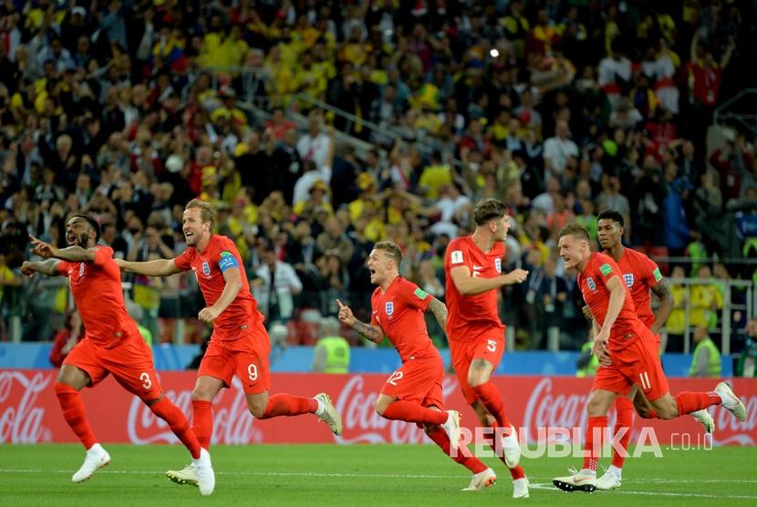 Selebrasi pemain timnas Inggris usai mengalahkan Kolombia lewat drama adu penalti.