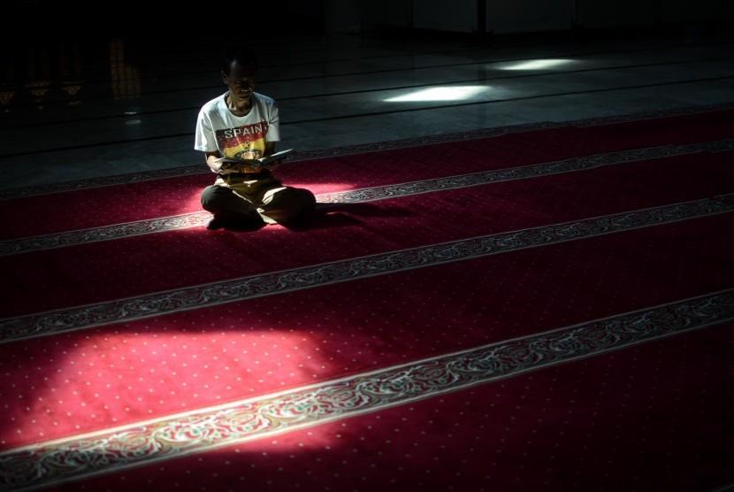 Muslims read the Holy Quran in the Masjid Raya Bandung, West Java.