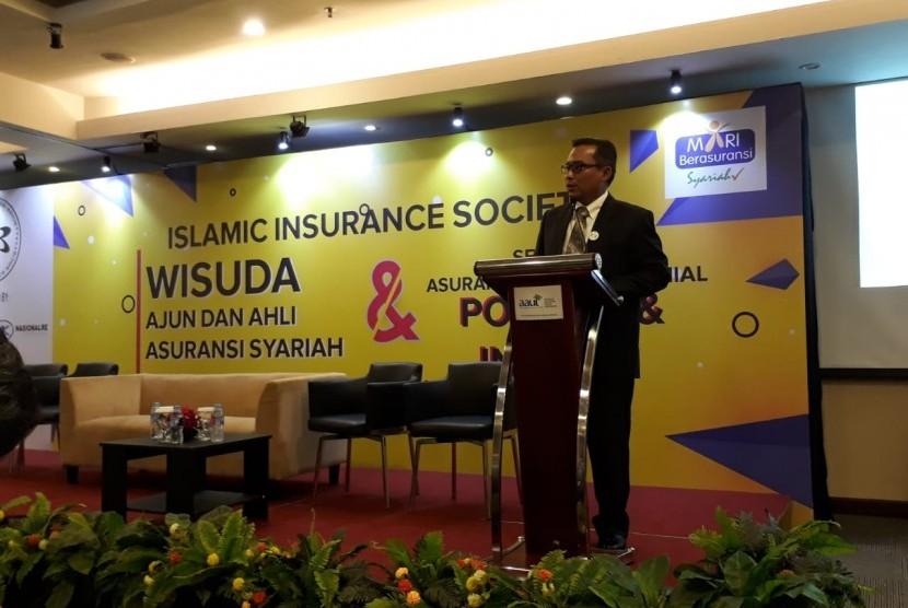 Acara Wisuda dan Seminar Asuransi Syariah di Gedung Permata Kuningan, Jakarta Selatan, Selasa (4/12).